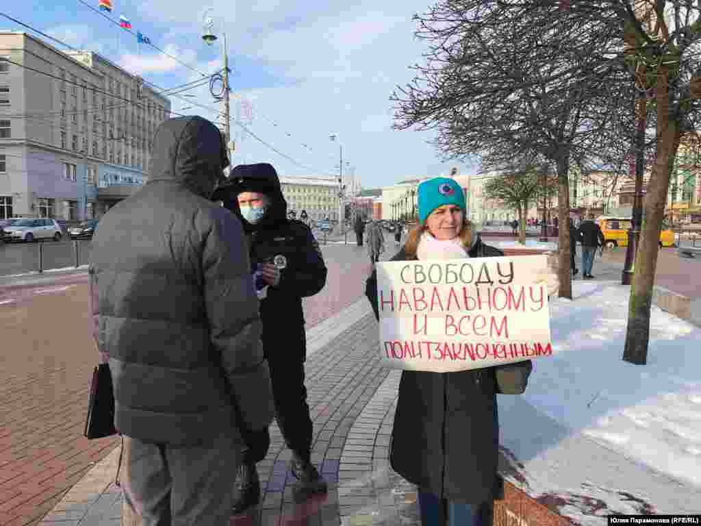 A one-person protest in the Baltic Sea city of Kaliningrad, a Russian exclave between Poland and Lithuania. The woman's poster calls for freedom for Navalny and all political prisoners.