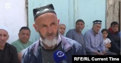 """In the Tajik village of Chorkukh, the only son of Khoshim Khomroyev was one of those killed during the April 2021 fighting with Kyrgyzstan. """"He wanted to defend his homeland,"""" commented Khomroyev, as male villagers sat along the street to pray for Chorkukh's victims"""