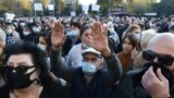 Armenians take part in a protest against the Moscow-brokered peace deal with Azerbaijan on November 13, 2020 in Yerevan's Freedom Square.