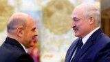 BELARUS -- Russian Prime Minister Mikhail Mishustin, left, shakes hands with Belarusian President Alyaksandr Lukashenka prior to their talks in Minsk, Belarus, Thursday, September 3, 2020