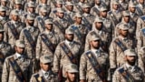 "IRAN -- Members of Iran's Islamic Revolutionary Guard Corps (IRGC) stand in formation during the annual ""Sacred Defence Week"" military parade marking the anniversary of the outbreak of the devastating 1980-1988 war with Saddam Hussein's Iraq, in Tehran, S"