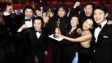"Best Picture Award winners for ""Parasite"" pose onstage during the 92nd Annual Academy Awards"