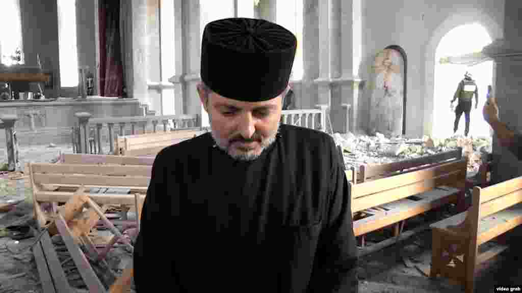 A priest inside the damaged Ghazanchetsots Cathedral, a 19th-century Armenian Apostolic church in the Karabakhi town of Shushi, called Shusha in Azerbaijani.