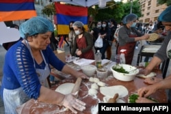 Refugees from Nagorno Karabakh bake the region's traditional, herb-stuffed flatbread in Yerevan to raise money for Karabakh.