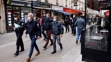Police officers patrol a street with restaurants in Paris on October 6, 2020, to inspect the implementation of new sanitary measures.