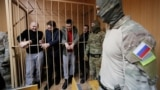 RUSSIA -- Detained crew members of Ukrainian naval ships, which were seized by Russia's FSB security service in November 2018, stand inside a defendants' cage as they attend a court hearing in Moscow, January 15, 2019