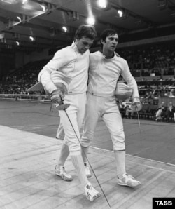 The USSR's fencing gold medalist Viktor Krovopuskov (right) and silver medalist Mikhail Burtsev at the 1980 Moscow Olympics