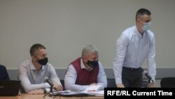 Карелия. Суд над руководством ИК-9. Слева сидит Иван Савельев, справа стоит Иван Ковалев.