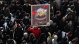 IRAN -- A portrait of slain Iranian Revolutionary Guards Corps (IRGC) Lieutenant general and commander of the Quds Force Qasem Soleimani is paraded as thousands of mourners gather to pay tribute for his funeral in Tehran, Iran, 06 January 2020.