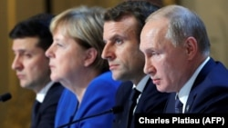 Talking about talking peace: Ukraine's President Volodymyr Zelenskiy, German Chancellor Angela Merkel, French President Emmanuel Macron, and Russia's President Vladimir Putin attend a press conference after their December 9 summit.