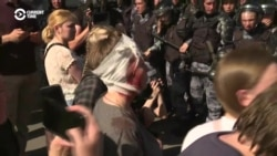 Police Beat, Detain Protesters And Opposition Figures At Moscow Rally
