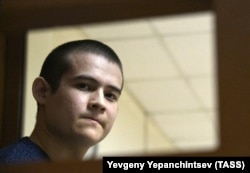 Russian conscript Ramil Shamsutdinov, charged with murder and attempted murder, attends a December 28, 2020 court hearing. He was sentenced to 24 1/2 years in prison in January 2021.