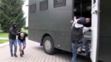 BELARUS -- Belarusian KGB officers detain a Russian man in a sanitarium outside in Minsk, July 29, 2020