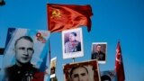 KAZAKHSTAN - ALMATY - IMMORTAL REGIMENT MARCH - VICTORY DAY - STALIN'S PORTRAIT