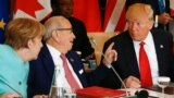 Tunisia's President Beji Caid Essebsi (C) gestures to U.S. President Donald Trump as German Chancellor Angela Merkel (L) looks on at the G7 Summit expanded session in Taormina, Sicily, Italy May 27, 2017.