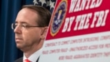 U.S. -- U.S. Deputy Attorney General Rod Rosenstein speaks at a news conference with other law enforcement officials at the Justice Department to announce nine Iranians charged with conducting massive cyber theft campaign, in Washington, March 23, 2018