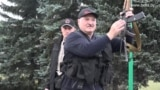 BELARUS -- Belarusian President Alyaksandr Lukashenka holds an automatic rifle and wearing body armor as he arrives at his residence in Minsk, August 23, 2020