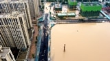 CHINA -- An aerial view shows the flooded areas following heavy rainfall in Zhengzhou, Henan province, China July 21, 2021. Picture taken with a drone. cnsphoto via REUTERS ATTENTION EDITORS - THIS IMAGE WAS PROVIDED BY A THIRD PARTY. CHINA OUT.