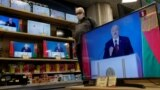 Belarusian President Alyaksandr Lukashenka is seen on TV screens at a Minsk electronics store on August 4, 2020 during his annual state-of-the-nation speech.
