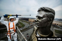 A worker cleans Moscow's statue of Yuri Gagarin, the first person to fly into outer space, ahead of Russia's 2019 Cosmonautics Day.