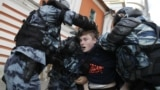 RUSSIA – Law enforcement officers detain a man after a rally to demand authorities allow opposition candidates to run in the upcoming local election in Moscow, Russia August 10, 2019