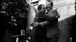 John Steinbeck (right) and Oleksandr Korneichuk, head of the Ukrainian Union of Writers, exchange hugs. Korneichuk was an informant, according to KGB documents.