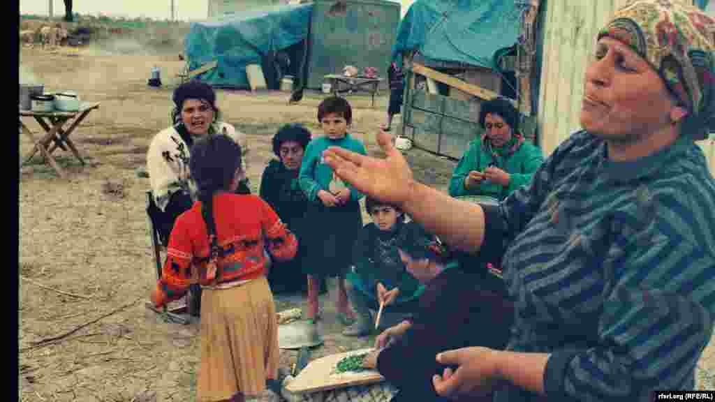 Ethnic Azerbaijani displaced persons from Agdam and the Karabakhi town of Shusha are seen in 1992, as full-fledged fighting over Azerbaijan's breakaway Nagorno Karabakh region began. Nearly 30 years later, some ethnic Armenian civilians, in turn, fled the Agdam district for a school in the Karabakhi-controlled town of Martakert, 27 kilometers to the north of the town of Aghdam.