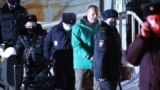 RUSSIA -- Navalnyi is escorted by police after a court hearing, in Khimki, Moskow, 18Jan2021