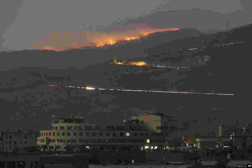 "A forest burns in the mountains outside Karabakh's main town of Stepanakert (Khankendi) on October 31, 2020, after what Armenia alleged was an Azerbaijani attack with white phosphorus munitions. Azerbaijan rejected the charge as ""false and fake,"" Turkey's official Anadolu Agency reported. On November 20, 2020, the Azerbaijan National Agency for Mine Action detonated what it claimed were Armenian white phosphorus munitions in the formerly Armenian-occupied districts of Fuzuli and Jabrayli, outside of Karabakh."