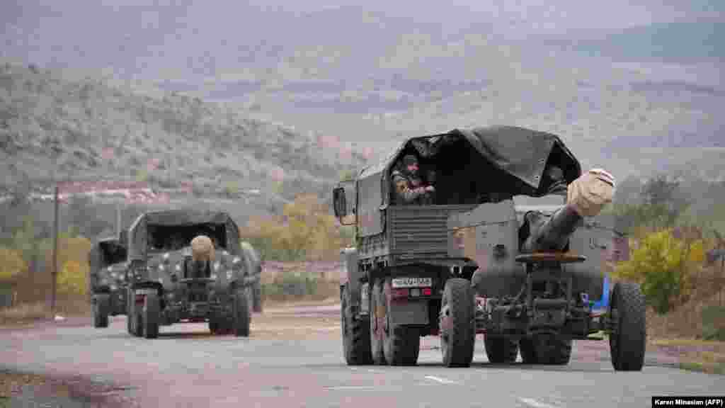 Armenian artillery leaves the town of Agdam, the seat of Azerbaijan's Agdam district, on November 19, 2020. The next day, the Azerbaijani army retook command of Agdam for the first time in more than 27 years.