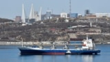 Vladivostok, Russia - A vessel sails with backdrop of the Russian far-eastern city of Vladivostok