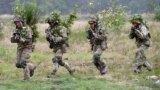 UKRAINE -- Soldiers take part in an exercise at the Yavoriv military training ground, close to Lviv, September 24, 2021
