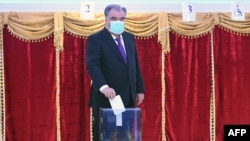 Tajik President Emomali Rakhmon, a presidential candidate for the fifth time, casts his ballot at a polling station in Dushanbe during Tajikistan's presidential election on October 11, 2020, amid the ongoing coronavirus disease pandemic.