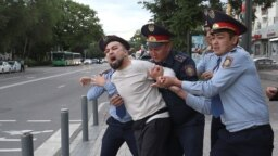 KAZAKHSTAN -- Law enforcement officers detain a man during an opposition rally held by critics of Kazakh President Kassym-Jomart Tokayev, who protest over his election in Almaty, Kazakhstan June 12, 2019