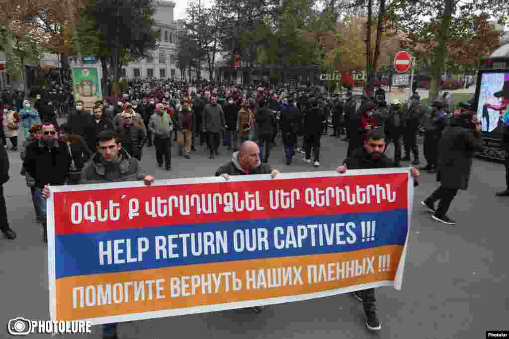 Armenian intellectuals march to the Russian Embassy in Yerevan on November 29, 2020 to demand Russia's help in locating missing Armenian soldiers and to call for Azerbaijan to return all prisoners. Petitions also have been made to the French and U.S. embassies. Ordinary Azerbaijanis also have been struggling to receive information from their defense ministry about the status of missing relatives. Russian Foreign Minister Sergei Lavrov has underlined that Russian peacekeepers are assigned to facilitate the exchange of bodies and prisoners, but noted on December 1, 2020 the need for an exact list of who is missing.