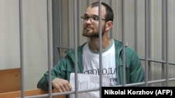 Алексей Миняйло в Пресненском суде. Фото: AFP