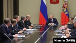 President Vladimir Putin chairs a meeting with members of Russia's Security Council at the Novo-Ogaryovo state residence outside Moscow on January 20.
