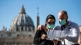 ITALY -- Tourists wearing protective face masks visit St. Peter's Square, Vatican City, 24 February 2020.