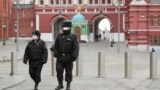 RUSSIA -- Russian police officers patrol the deserted Red Square in Moscow, March 30, 2020