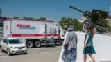 RUSSIA -- People walk to get a shot of Russia's Sputnik V coronavirus vaccine in a mobile vaccination center in Yuzhno-Sakhalinsk, Sakhalin Island in Russia's Far East, June 18, 2021