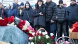 RUSSIA -- People gather at a makeshift memorial to victims of the March 25, 2018 fire at the Zimnyaya Vishnya in Kemerovo, March 25, 2019