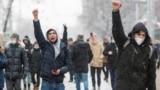 Moscow, Russia - Protestors raise their fists during a rally in support of jailed Russian opposition leader Alexei Navalny