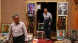 Portraits of Mao Zedong, Vladimir Lenin and Karl Marx are displayed outside an antique shop in the old town in Kashgar