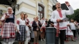 BELARUS -- People sing as they attend an opposition demonstration to protest against presidential election results in front of the Janka Kupala National Academic Theatre, in Minsk, August 20, 2020