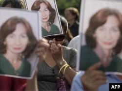 Акция памяти Натальи Эстемировой 16 июля 2009 года. Фото: AFP
