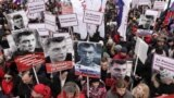 RUSSIA – People attend a rally in memory of Russian opposition politician Boris Nemtsov, who was assassinated in 2015, in Moscow, Russia February 24, 2019