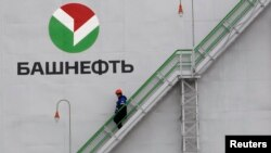 Russia -- An employee walks down stairs at Bashneft - Novoil refinery in the city of Ufa, Bashkortostan, April 11, 2013