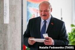 Belarusian President Alyaksandr Lukashenka casts his ballot in Minsk on August 9, 2020.