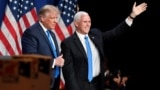 President Donald J. Trump and Vice President Mike R. Pence react at the Republican National Convention at the Republican National Convention in Charlotte, North Carolina, U.S., August 24, 2020. David T. Foster/Pool via REUTERS