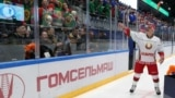 BELARUS -- Belarusian President Alyaksandr Lukashenka throws a toy to spectators after an amateur ice hockey game, as competitions in Belarus continue despite the rest of major sports events were shut down because of the outbreak of coronavirus disease (C